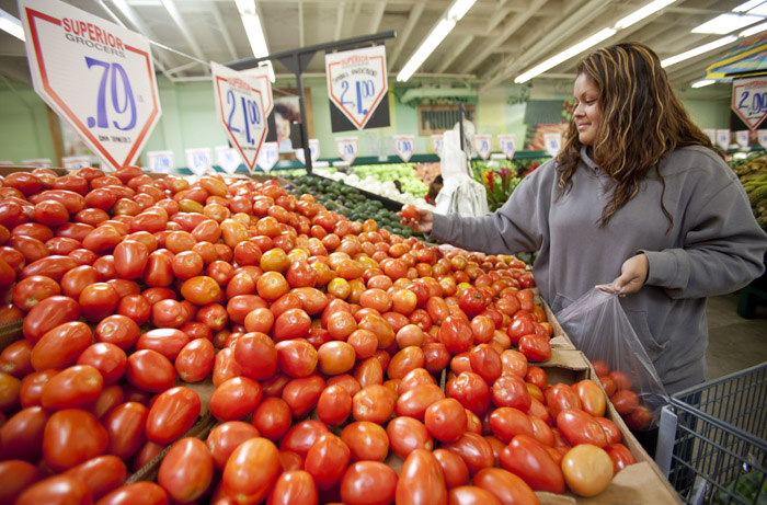 Sonia Romero shops recently for tomatoes at a Superior Grocers store in Los Angeles. A monthly survey shows consumers are losing faith that the economy will keep improving.