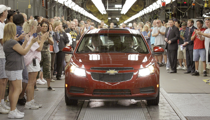 General Motors workers cheer as the first Chevrolet Cruze compact sedan rolls off the assembly line at the GM factory in Lordstown, Ohio, in 2010.