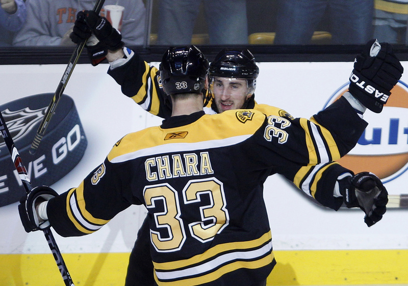 Zdeno Chara is congratulated by Brad Marchand after his first-period goal tonight against the Flyers in Game 3 of the Eastern Conference semifinals at Boston. The Bruins won 5-1 and lead the series, 3-0.