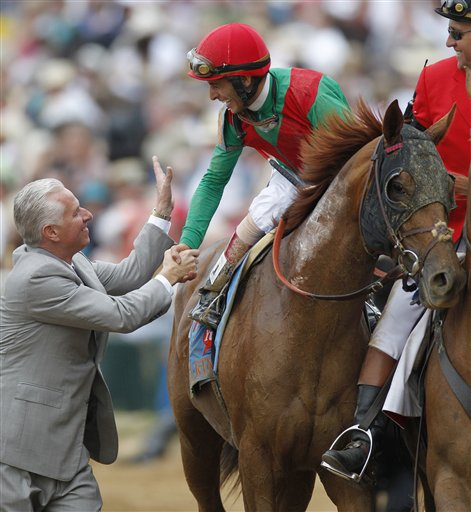 Trainer Todd Pletcher, left, congratulates John Velazquez after Velazquez rode Animal Kingdom to victory during the 137th Kentucky Derby horse race at Churchill Downs Saturday.