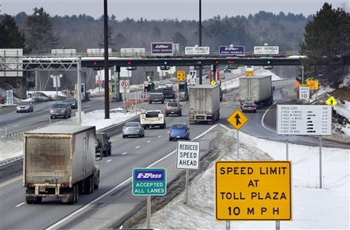 FILE - In this Feb. 2011 file photo, traffic approaches Maine Turnpike toll booths in Gardiner, Maine. A legislative committee is suggesting cutting Maine Turnpike Authority board terms from seven years to four. The authority is under scrutiny after an audit uncovered thousands of dollars in lavish expenses and gift cards. (AP Photo/Robert F. Bukaty, File)