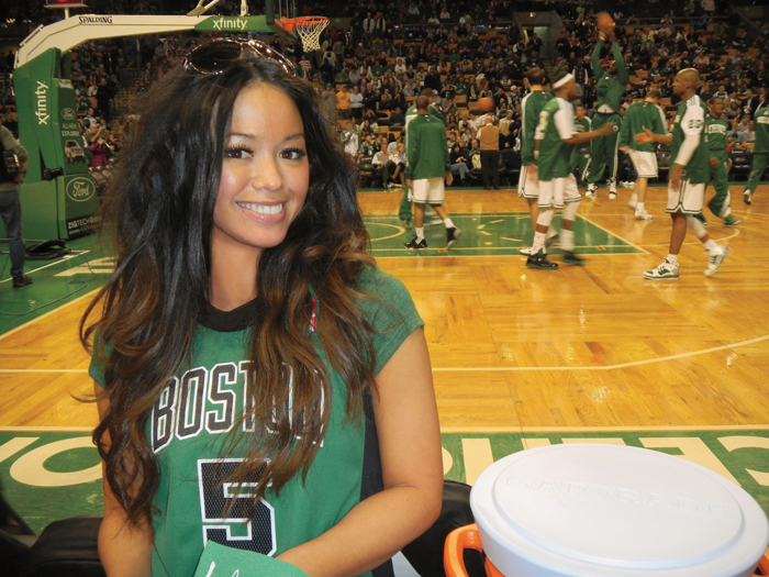 A photo featured in the Miss June centerfold in Playboy features Mei-Ling Lam at a Celtics game.