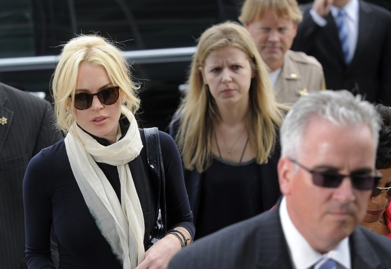 "Lindsay Lohan, right, says she's been the focus of ""obsessive and harassing behavior"" on the part of David Cocordan for about two years. Cocordan, 38, has sent her more than 100 text messages, including ones that claim he is engaged to her."
