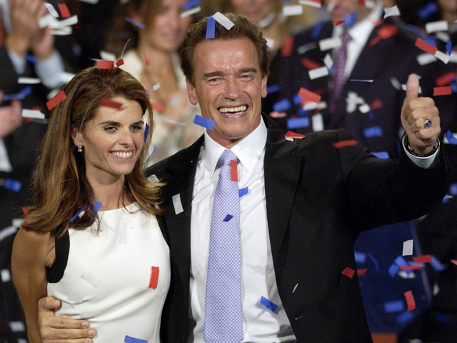 In this Oct. 7, 2003, file photo former California Governor Arnold Schwarzenegger and his wife Maria Shriver celebrate his victory in the California gubernatorial recall election.