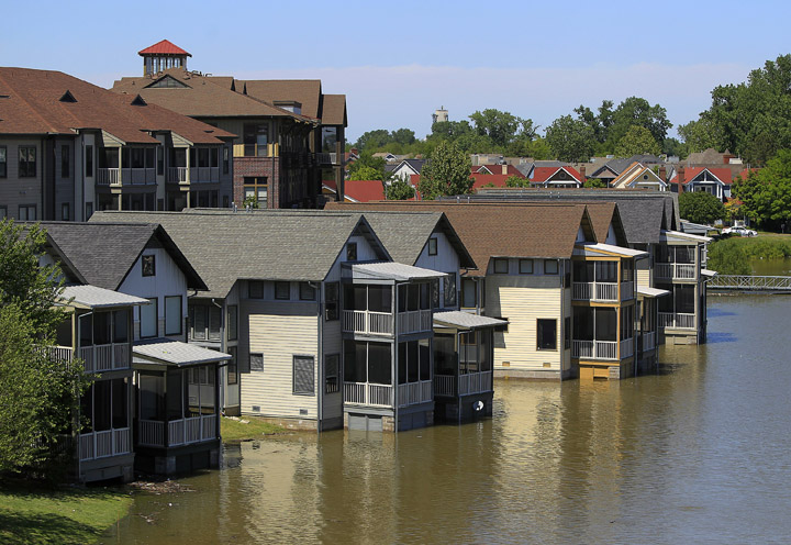 Homes on Mud Island that are usually high above the water level are met by the rising waters of the Mississippi River in Memphis, Tenn. The National Weather Service is predicting a 48-foot crest of the Mississippi River on May 11.