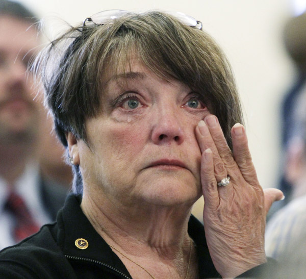 Marnie Gardner, of Greene, wipes tears from her eyes during the ceremony to honor Mainers who gave their lives in Iraq and Afghanistan, at the State House in Augusta, today. Gardner's grandson, Cpl. Andrew L. Hutchins, of New Portland, Maine died on Nov. 8, 2010, in Afghanistan.
