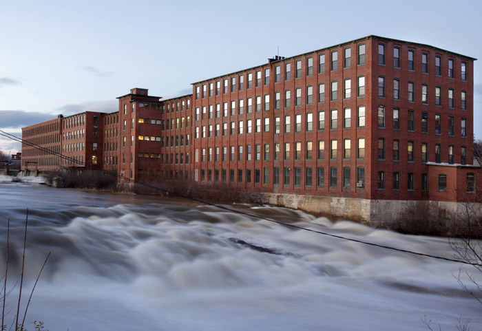 The Presumpscot River flows past the Dana Warp Mill in Westbrook in this 2009 photo. The former spinning mill, built in 1881, has been renovated into a modern multi-use office building.