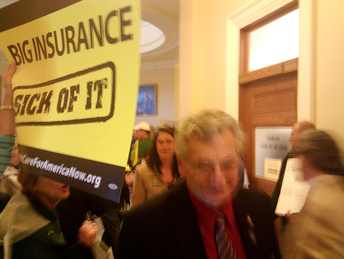 The scene this morning as protesters line the corridors of the State House to greet lawmakers as they arrive.