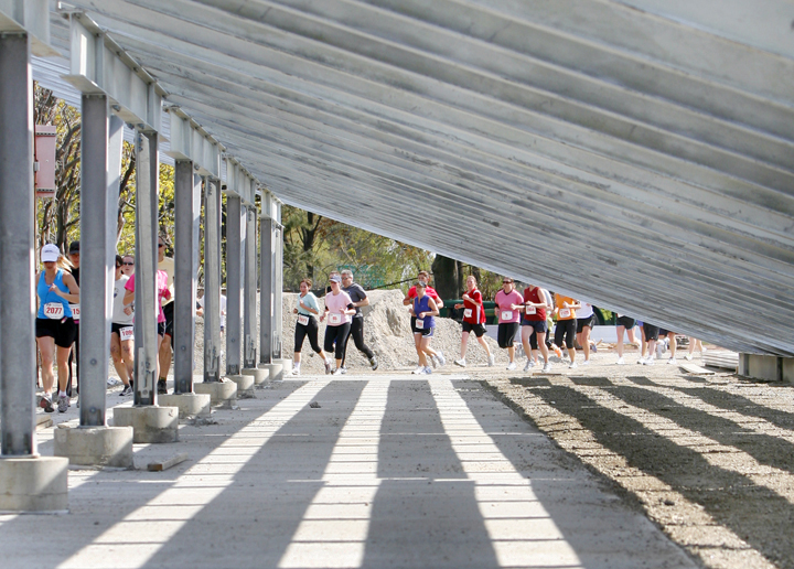 Runners pass the bleachers at Fitzpatrick Stadium during the Mothers' Day 5K.