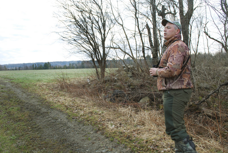 Joe Saltalamachia scouts for turkeys last week in Unity, where he's gotten permission to hunt on farmland when the spring season begins Monday. Waldo and Knox counties, with their mix of open farm fields and woods, have become popular areas for turkey hunters.