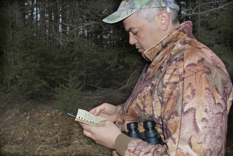 Joe Saltalamachia makes notes about birds he spotted while scouting in Unity.
