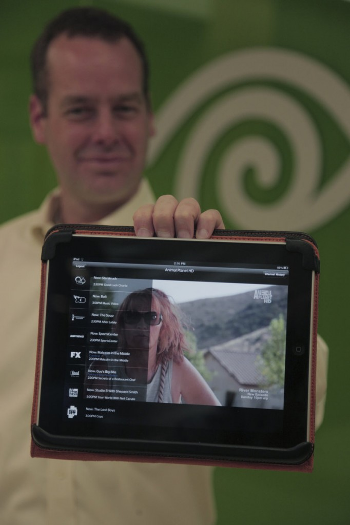 Gary Underwood, vice president of communications for Time Warner Cable North Texas, demonstrates the iPad app used for streaming television content.