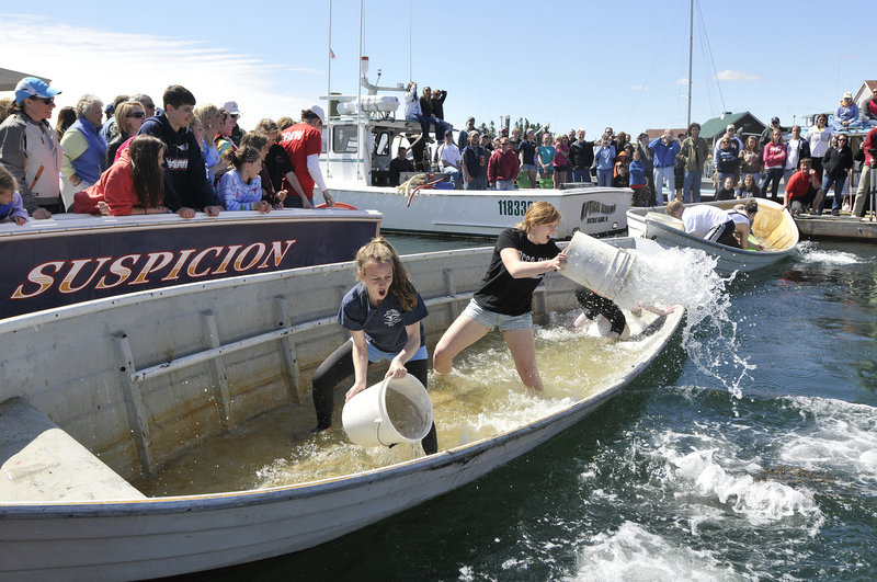 Mia DeGroote, left, of Boothbay and Katie Burns of Cumberland give it their best in the dory bailing competition.