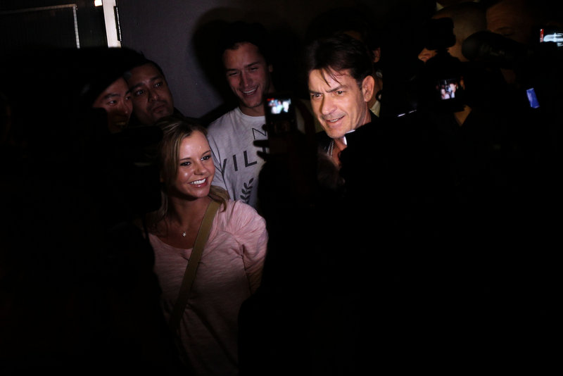 Charlie Sheen arrives at Chicago's Enclave nightclub April 3 after appearing at the Chicago Theater in the stage show he created when CBS fired him March 7.