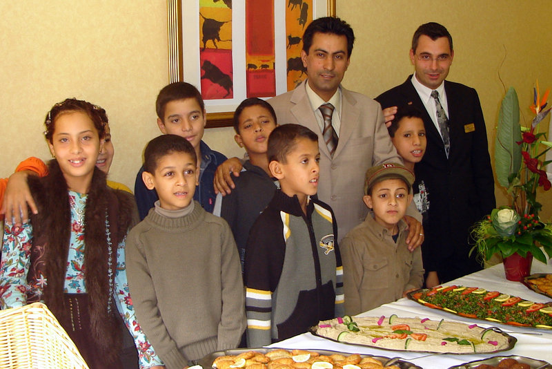 In this undated photo, Dr. Jebril Elabidi, center, poses in Montpellier, France, with some of the 400 or so children infected with HIV in a 1998 outbreak in a Benghazi, Libya, hospital. The pediatrician blames six foreign caregivers, not poor hospital hygiene, for the outbreak.