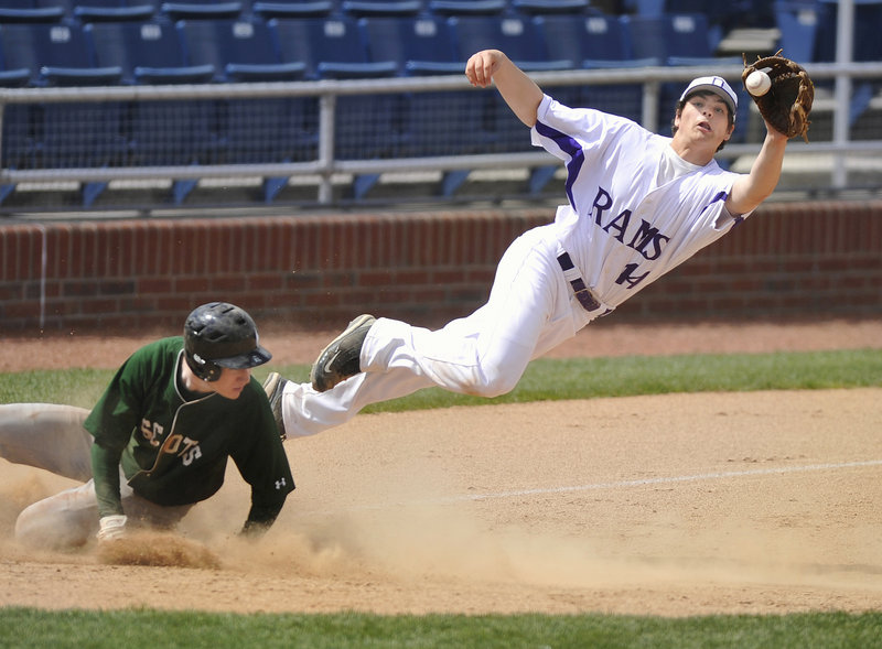 Jared Bell of Deering leaps to haul in an errant throw Saturday as Matt Burnell of Bonny Eagle slides safely into third base during their Telegram League game at Hadlock Field. Deering earned an 8-4 victory.