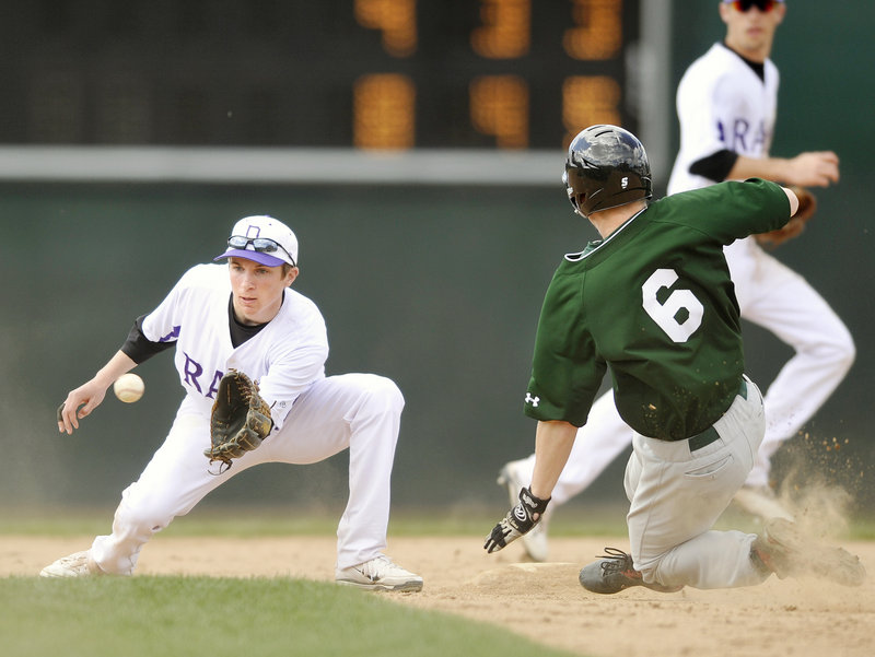 Matt Bevilacqua of Deering concentrates on the ball before applying a tag on Evan Spencer of Bonny Eagle, who was attempting to steal second.