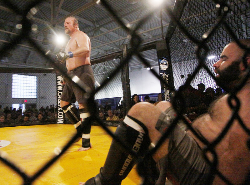 Kevin Armstrong, left, of Team Irish struts his stuff after defeating Greg Armstrong of the Bishops. Eighteen months after the sport was sanctioned in Maine, the fights began.