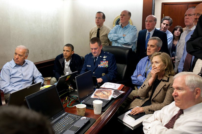 President Obama and Vice President Joe Biden, along with members of the national security team, track the mission against Osama bin Laden from the Situation Room of the White House on Sunday in this image released by the White House and digitally altered by the source to diffuse the paper in front of Secretary of State Hillary Rodham Clinton.