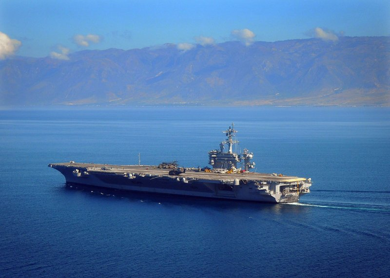 The aircraft carrier USS Carl Vinson maneuvers off the coast of Haiti in 2013.