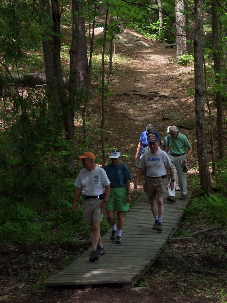 Tom Jewell, founder of Forest City Land Trust, leads a group at Presumpscot River Preserve.