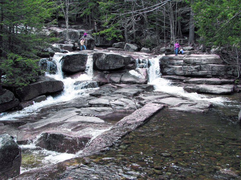 White Mountain National Forest's Moat Mountain Trail leads to Diana's Baths, a series of cascading waterfalls and pools.