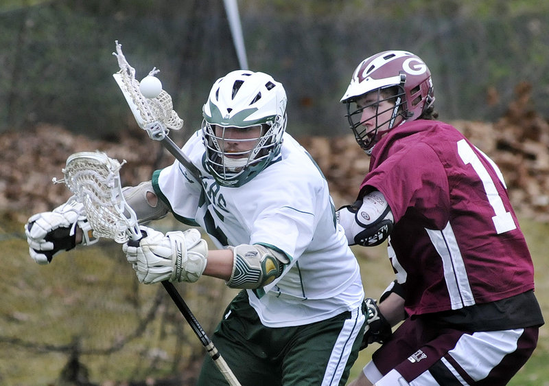 Erik Rost of Greely, right, and Luke Wendland of Waynflete seek to gain control of the ball. Waynflete improved its record to 3-1. Greely is 1-2.