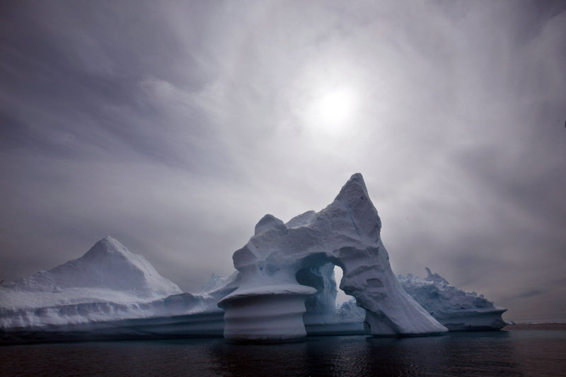 An iceberg floats off Ammassalik Island in eastern Greenland in July 2007. A climate change panel says that the melting of Arctic glaciers and ice caps, including Greenland's ice sheet, is expected to help raise global sea levels by 35 to 63 inches by the turn of the century.
