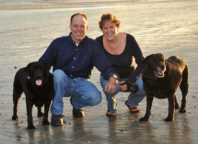 Lisa Ballou, John Torpie and their dogs, Marley and Katie, pose at Pine Point Beach in Scarborough in September 2010.