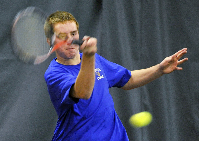 Tom Wilberg of Falmouth returns a shot during a doubles match against Cape Elizabeth. Either the Yachtsmen or Capers have been in nine of the past 10 state finals.