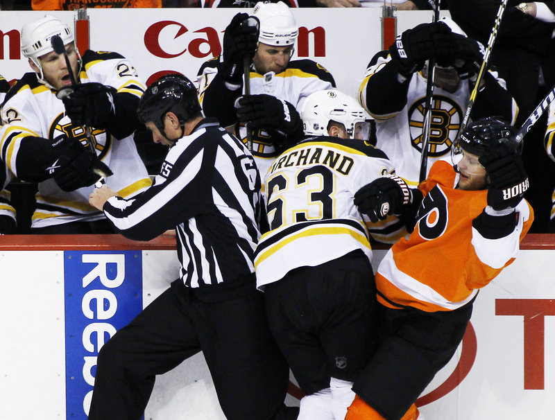 Lineman Pierre Raicot, left, gets tangled with Boston's Brad Marchand, center, and Philadelphia's Kris Versteeg on Wednesday night.