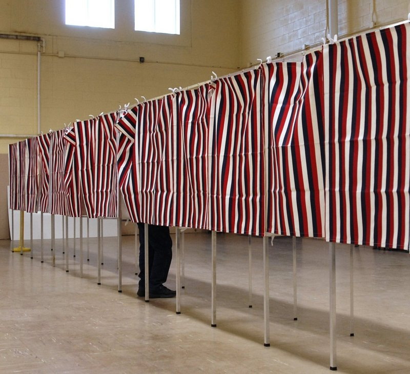 A lone voter fills out a ballot in Westbrook, a community said to be in an overpopulated Maine Senate district.