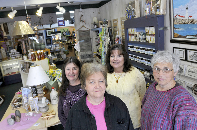 "At Stone Soup Artisans, from left, Deb Georgitis, Joanne Kenyon, Carol Funk and Sue Littlefield are among the dozen artists who staff the cooperative retail outlet. ""We couldn't do this if we had to pay salaries,"" Kenyon said."