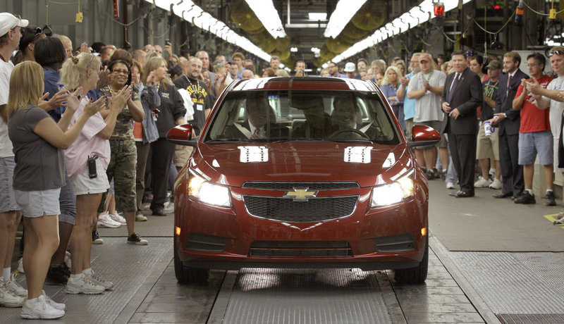 Workers cheer as the first Chevrolet Cruze compact sedan rolls off the assembly line last September at the GM factory in Lordstown, Ohio. Chevrolet sold 150,652 Cruzes in the first quarter of 2011, a 117 percent increase over a year ago.