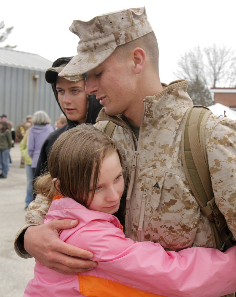 Lance Cpl. Tim Carter, 18, of Machias gets a hug from his11-year-old sister, Libby, before boarding a bus Thursday at the Marine Corps Reserve Training Center in Topsham.