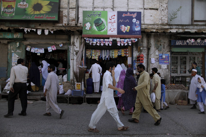 Pakistanis walk past shops in Abbottabad, Pakistan, the city where Osama bin Laden was found and killed earlier this week. The CIA had a safe house in the city and had been spying on the al-Qaida leader.