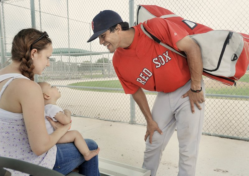 Will Vazquez, right, spends a moment with wife Hannah, and daughter Mia at spring training in Florida in March. He is in a second season as a backup catcher in Portland, where Hannah will celebrate her first Mother's Day.