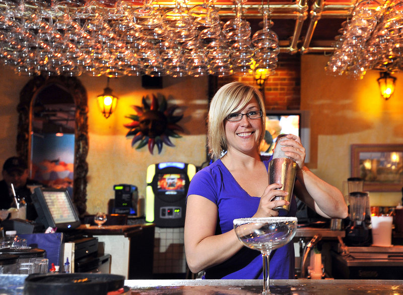 Bartender Amy Ridlon makes one of the many specialty margaritas available at Margaritas on Brown Street in Portland. The franchise serves 15 kinds of its signature drink.