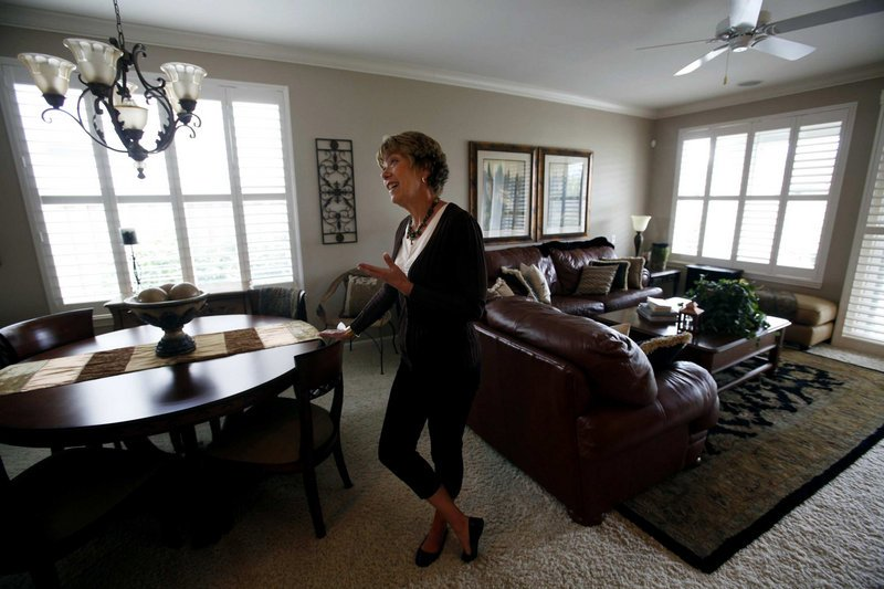 "Sheila Safley stands in her home in Lincoln Hills, Calif., one of the fastest-growing cities in the state. ""It's like a cruise ship that doesn't sail,"" she said of the Sun City retirement community where she lives, and where most of the growth has occurred."