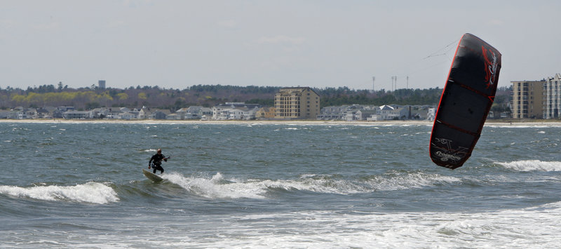 A kite surfer takes advantage of a strong wind at Pine Point Beach in Scarborough.