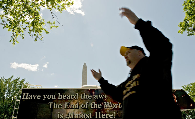 "Gary Vollmer of Alexandria, Va., gathers fellow believers who are spreading their message that the end of the world is near. Vollmer has taken a leave from his job with the Department of Homeland Security to volunteer his time to the cause. He's supposed to go back on May 23. ""But I'm not going back,"" he said. ""I'll be gone on the 21st."""
