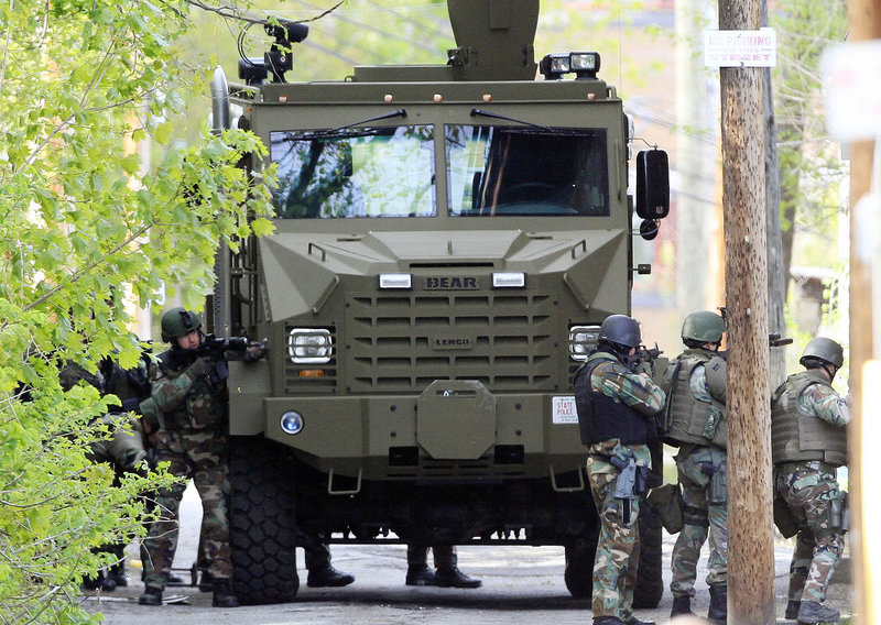 With the SWAT team ready, officials say they have made contact with the armed man holed up in Manchester, N.H.