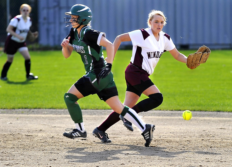 Brittany Murphy of Bonny Eagle is bound for third base as shortstop Billie Lamb of Windham chases down the ball.