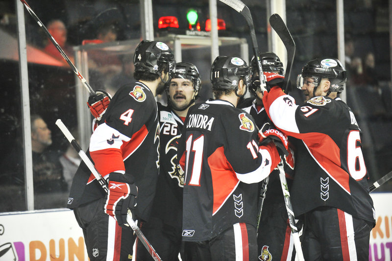 The Binghamton Senators celebrate Jim O'Brien's goal 25 seconds into the game Friday night at the Cumberland County Civic Center. It was not the start the Pirates would have liked.