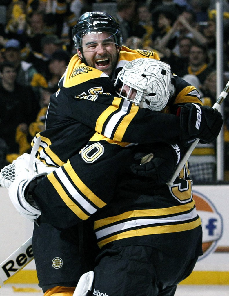 Johnny Boychuk celebrates with Bruins goalie Tim Thomas after their 5-1 win over the Flyers on Friday.