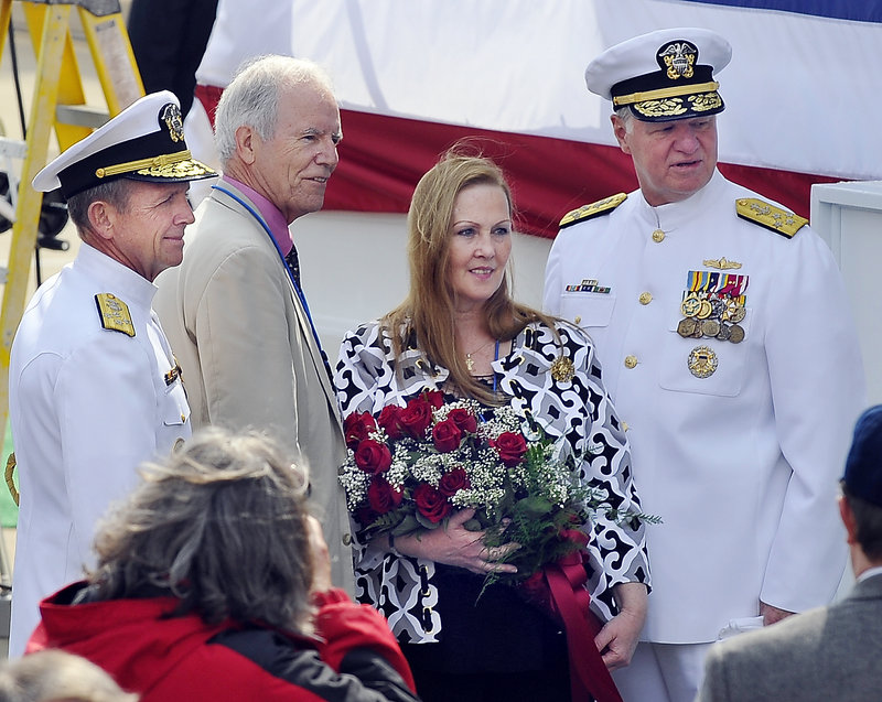 Lt. Michael Murphy's parents, Dan and Maureen Murphy, pose with Adm. Eric T. Olson, left, commander of U.S. special operations, and Adm. Gary Roughead, chief of naval operations.
