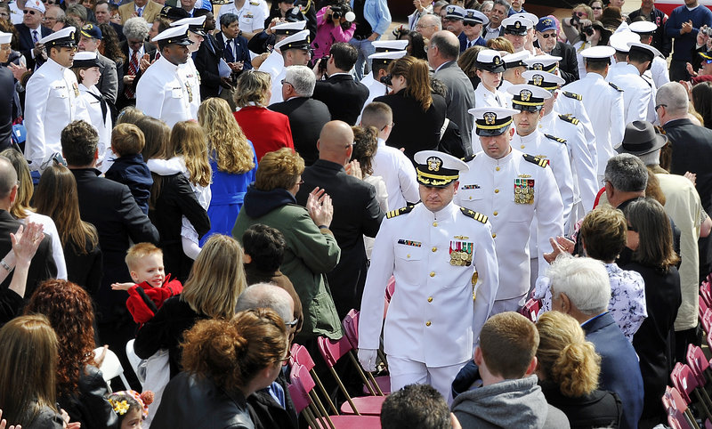 The ship's crew arrives at the ceremony to a standing ovation. The ship, which his family considers a floating monument to Lt. Michael Murphy and the others who died that day, is expected to be in its home port of Pearl Harbor by June 2012.