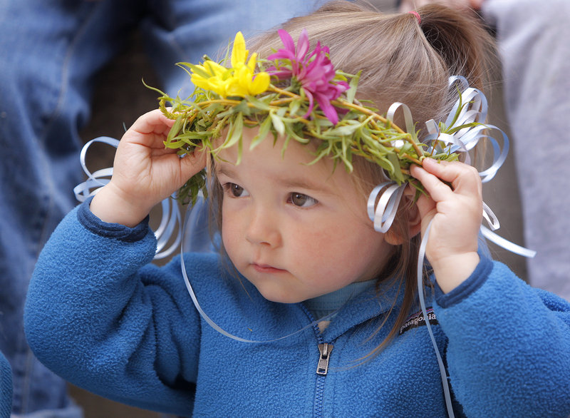 Willow West, 2, of Kennebunkport holds onto her crown while attending a fairy program at the Kennebunk Free Library.