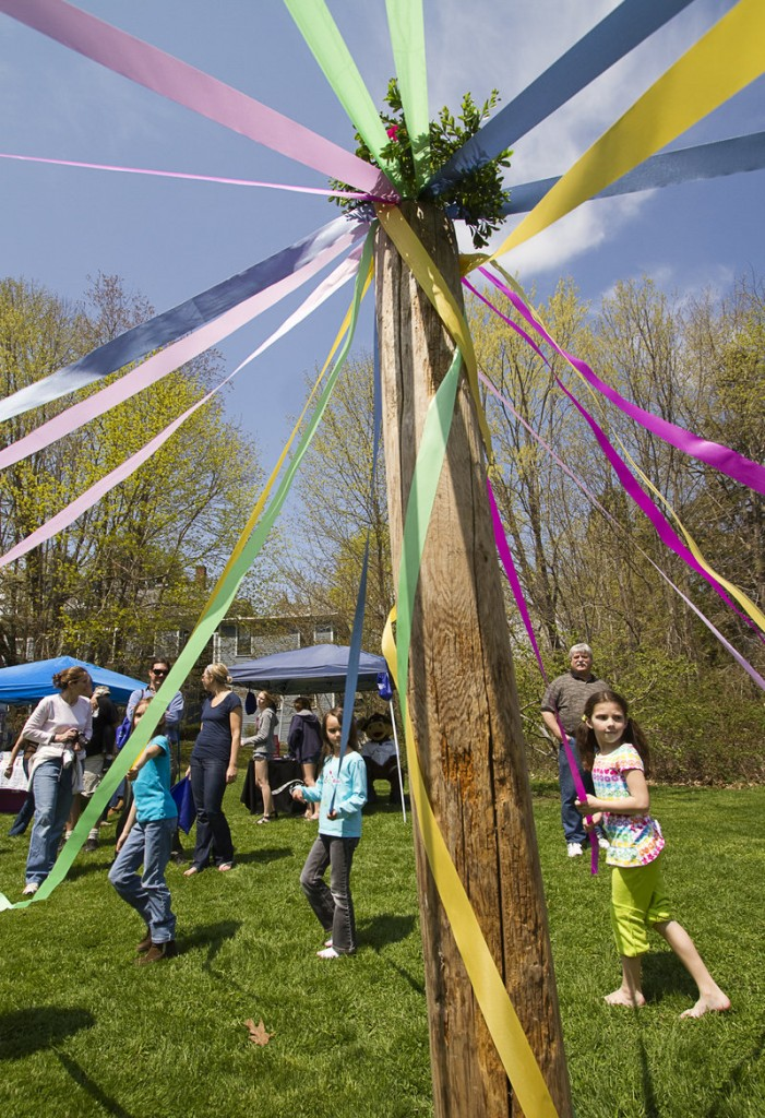 Young festival-goers dance around the maypole in Lafayette Park.