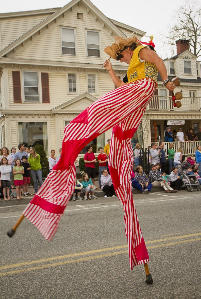Greg Frangolis of Portland's Shoestring Theater performs on stilts during the festival parade.